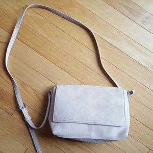 Light pink faux suede bag